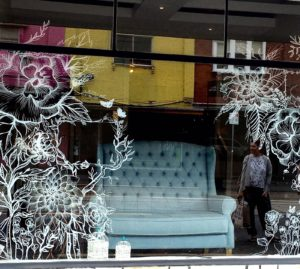 """Natural essence"", white sharpie on shop window"
